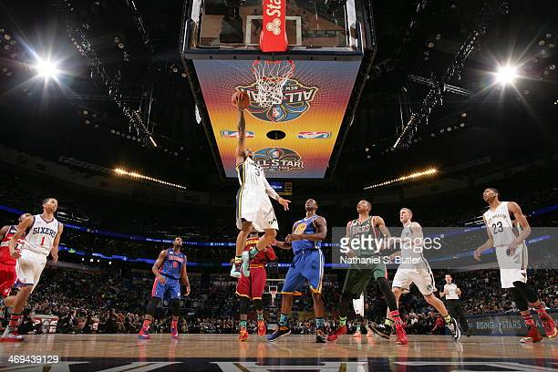 Trey Burke of Team Webber shoots against Harrison Barnes of Team Hill during the 2014 BBVA Compass Rising Stars Challenge at Smoothie King Center in...