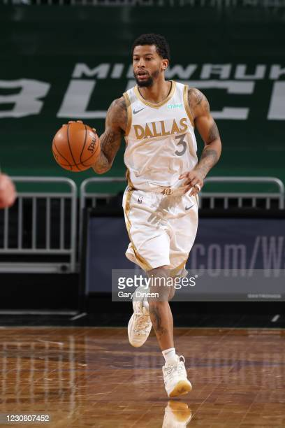 Trey Burke of the Dallas Mavericks handles the ball during the game against the Milwaukee Bucks on January 15, 2021 at the Fiserv Forum Center in...