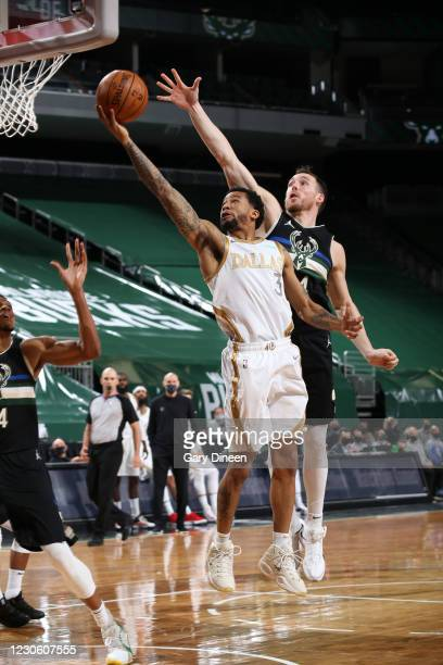 Trey Burke of the Dallas Mavericks shoots the ball during the game against the Milwaukee Bucks on January 15, 2021 at the Fiserv Forum Center in...