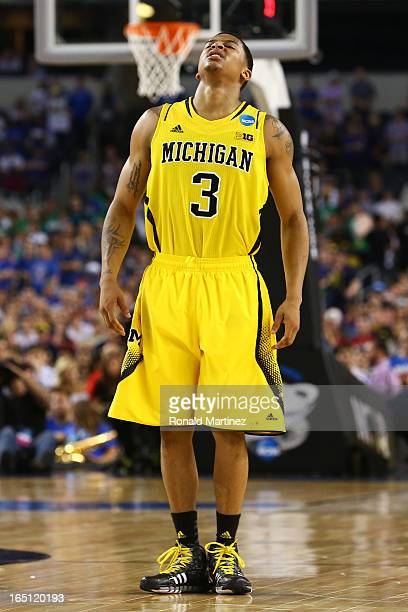 Trey Burke of the Michigan Wolverines reacts against the Kansas Jayhawks during the South Regional Semifinal round of the 2013 NCAA Men's Basketball...