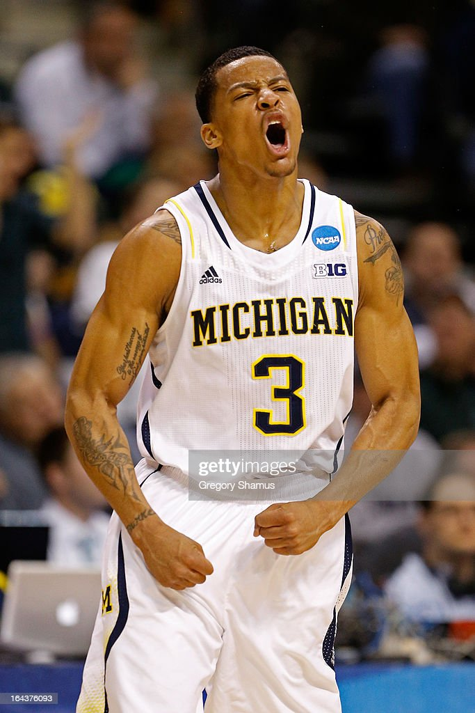 Trey Burke #3 of the Michigan Wolverines reacts in the first half against the Virginia Commonwealth Rams during the third round of the 2013 NCAA Men's Basketball Tournament at The Palace of Auburn Hills on March 23, 2013 in Auburn Hills, Michigan.