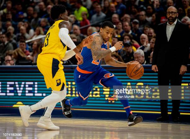 Trey Burke of the New York Knicks attempts to push past Aaron Holiday of the Indiana Pacers during the first half of the game at Bankers Life...