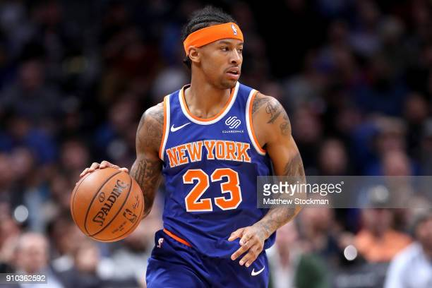Trey Burke of the New York Knicks brings the ball down the court against the Denver Nuggets at the Pepsi Center on January 25 2018 in Denver Colorado...