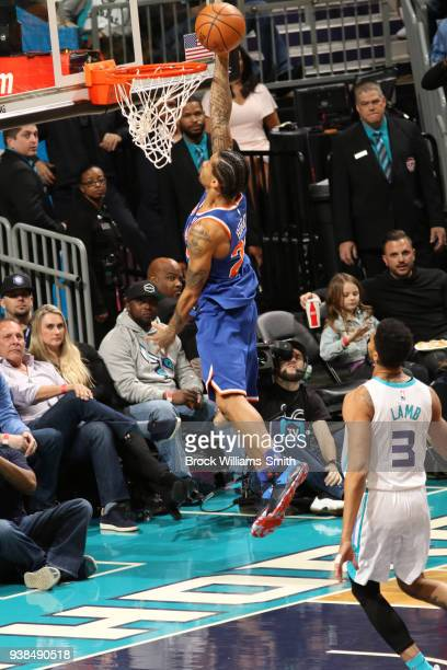 Trey Burke of the New York Knicks dunks against the Charlotte Hornets on March 26 2018 at Spectrum Center in Charlotte North Carolina NOTE TO USER...
