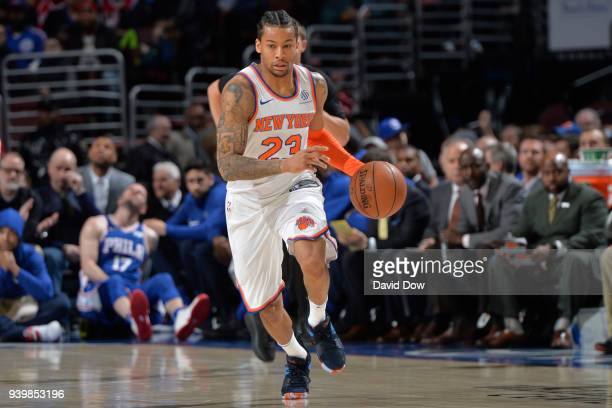 Trey Burke of the New York Knicks handles the ball against the Philadelphia 76ers on March 28 2018 at the Wells Fargo Center in Philadelphia...