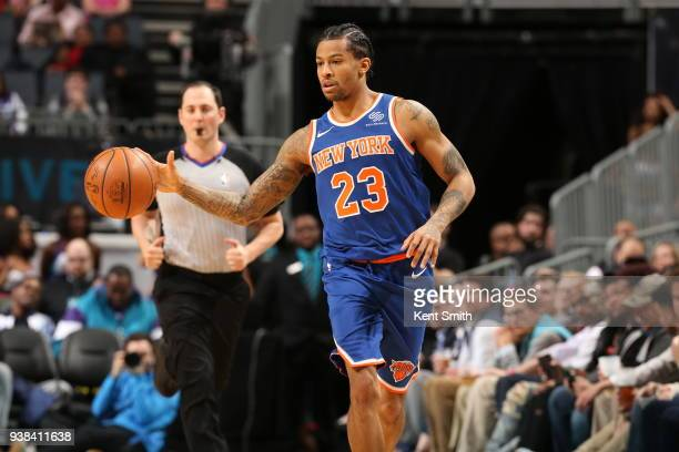 Trey Burke of the New York Knicks handles the ball against the Charlotte Hornets on March 26 2018 at Spectrum Center in Charlotte North Carolina NOTE...