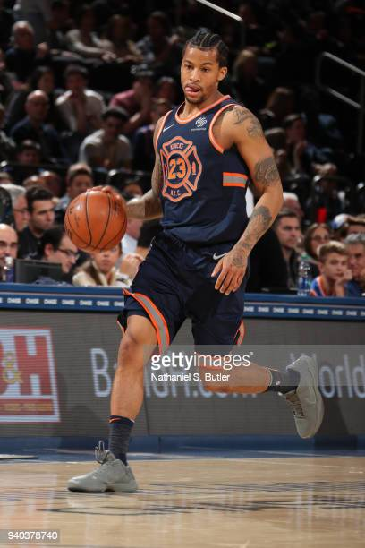 Trey Burke of the New York Knicks handles the ball during the game against the Detroit Pistons on March 31 2018 at Madison Square Garden in New York...