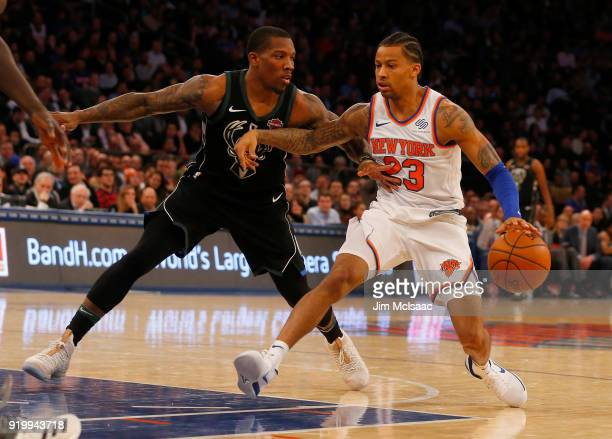 Trey Burke of the New York Knicks in action against Eric Bledsoe of the Milwaukee Bucks at Madison Square Garden on February 6 2018 in New York City...