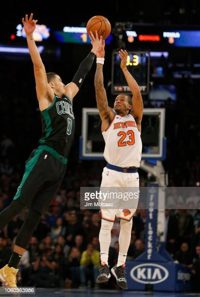 Trey Burke of the New York Knicks in action against Jayson Tatum of the Boston Celtics at Madison Square Garden on October 20 2018 in New York City...
