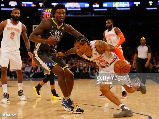 Trey Burke of the New York Knicks in action against Jordan Bell of the Golden State Warriors at Madison Square Garden on February 26 2018 in New York...