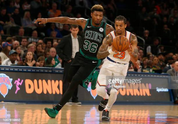 Trey Burke of the New York Knicks in action against Marcus Smart of the Boston Celtics at Madison Square Garden on October 20 2018 in New York City...