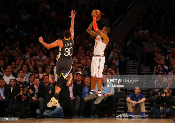 Trey Burke of the New York Knicks in action against Stephen Curry of the Golden State Warriors at Madison Square Garden on February 26 2018 in New...