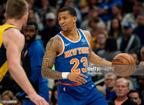 Trey Burke of the New York Knicks looks to pass the ball during the first half of the game against the Indiana Pacers at Bankers Life Fieldhouse on...
