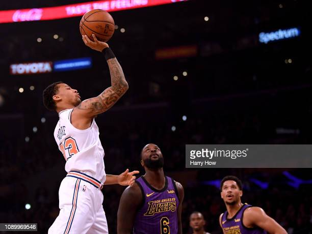 Trey Burke of the New York Knicks shoots in front of Lance Stephenson and Josh Hart of the Los Angeles Lakers during the first quarter at Staples...