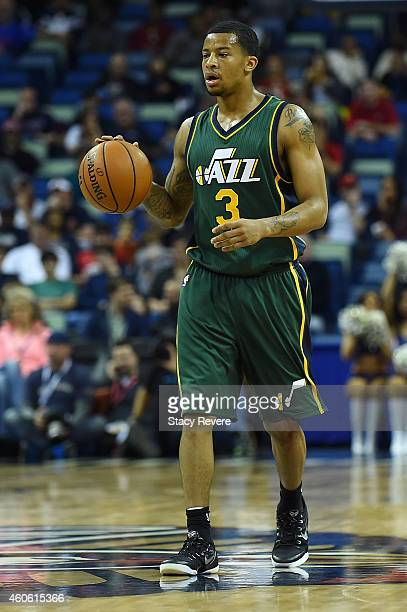 Trey Burke of the Utah Jazz brings the ball up court during the first half of a game against the New Orleans Pelicans at the Smoothie King Center on...