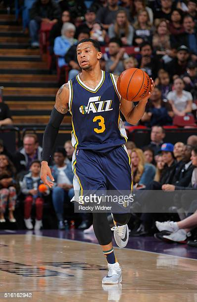 Trey Burke of the Utah Jazz brings the ball up the court against the Sacramento Kings on March 13 2016 at Sleep Train Arena in Sacramento California...