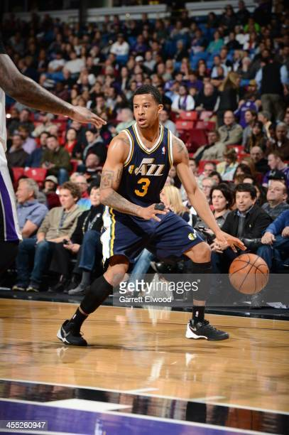 Trey Burke of the Utah Jazz controls the ball against the Sacramento Kings at Sleep Train Arena on December 11 2013 in Sacramento California NOTE TO...