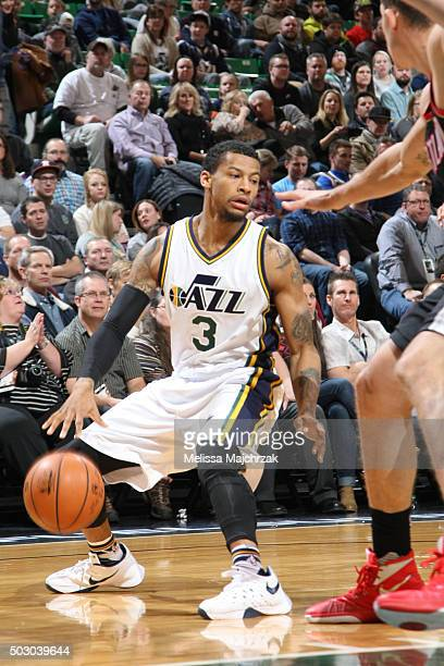 Trey Burke of the Utah Jazz dribbles the ball against the Portland Trail Blazers on December 31 2015 at vivintSmartHome Arena in Salt Lake City Utah...