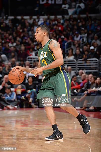 Trey Burke of the Utah Jazz drives against the Los Angeles Clippers on December 29 2014 at STAPLES Center in Los Angeles California NOTE TO USER User...