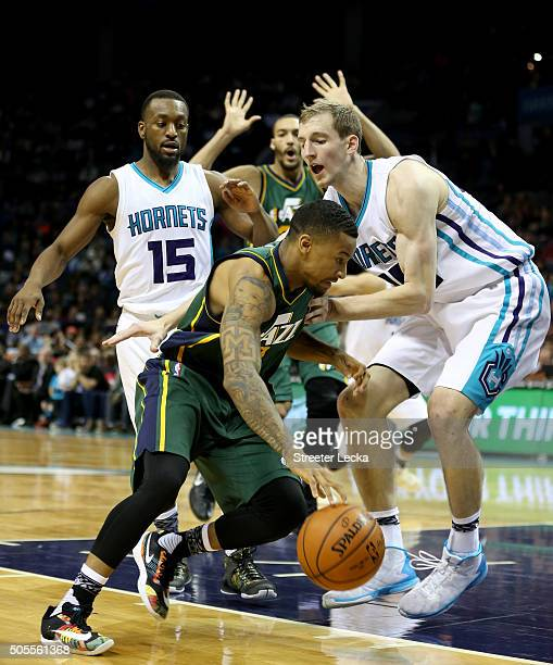 Trey Burke of the Utah Jazz drives to the basket against Cody Zeller of the Charlotte Hornets during their game at Time Warner Cable Arena on January...