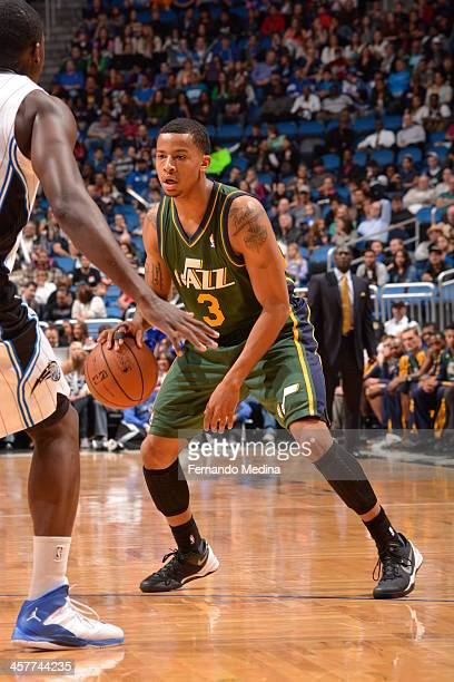 Trey Burke of the Utah Jazz drives to the basket against the Orlando Magic during the game on December 18 2013 at Amway Center in Orlando Florida...