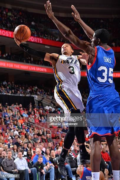 Trey Burke of the Utah Jazz goes up for the layup against the Philadelphia 76ers at the Wells Fargo Center on March 8 2014 in Philadelphia...