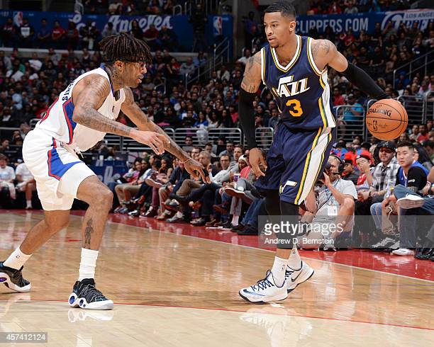 Trey Burke of the Utah Jazz looks to pass the ball against Chris DouglasRoberts of the Los Angeles Clippers during the game at the STAPLES Center on...