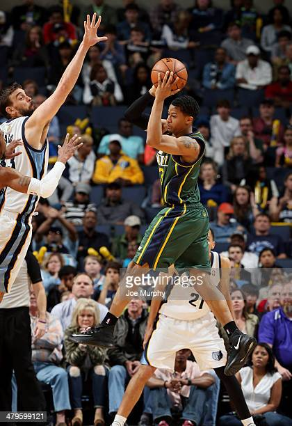 Trey Burke of the Utah Jazz passes against the Memphis Grizzlies on March 19 2014 at FedExForum in Memphis Tennessee NOTE TO USER User expressly...