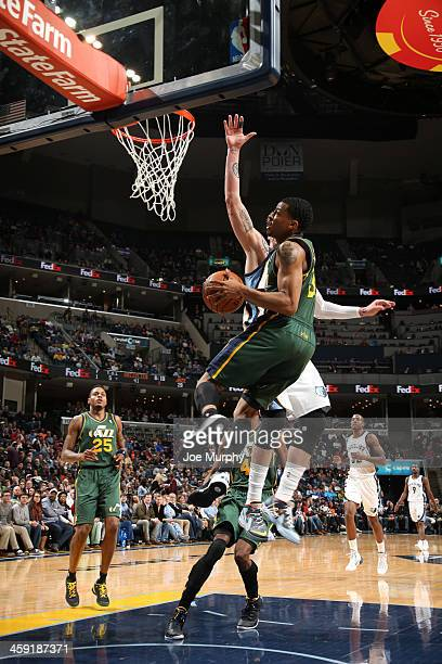 Trey Burke of the Utah Jazz shoots against the Memphis Grizzlies on December 23 2013 at FedExForum in Memphis Tennessee NOTE TO USER User expressly...