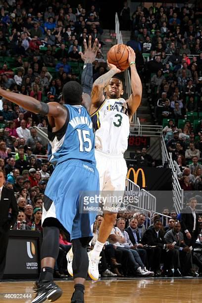 Trey Burke of the Utah Jazz shoots against the Minnesota Timberwolves at EnergySolutions Arena on December 30 2014 in Salt Lake City Utah NOTE TO...