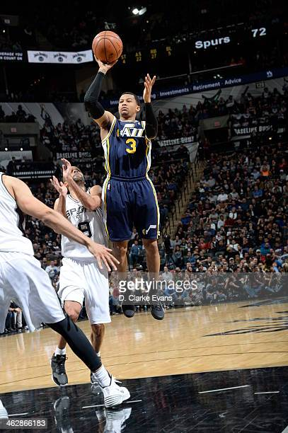 Trey Burke of the Utah Jazz shoots against the San Antonio Spurs at the ATT Center on January 15 2014 in San Antonio Texas NOTE TO USER User...
