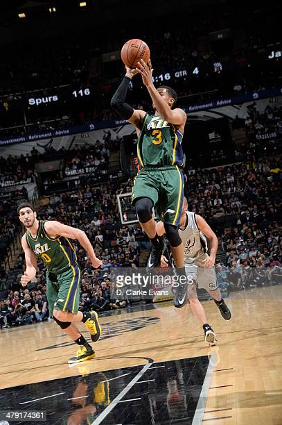 Trey Burke of the Utah Jazz shoots against the San Antonio Spurs at the ATT Center on March 16 2014 in San Antonio Texas NOTE TO USER User expressly...