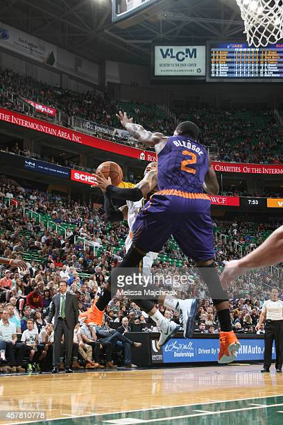 Trey Burke of the Utah Jazz shoots the ball against the Phoenix Suns during the game at EnergySolutions Arena on October 24 2014 in Salt Lake City...