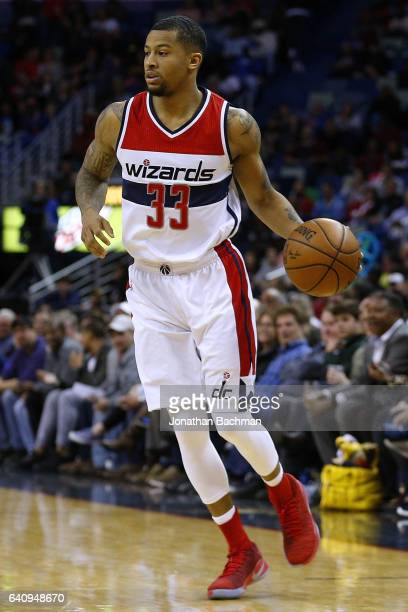 Trey Burke of the Washington Wizards drives with the ball during the second half of a game against the New Orleans Pelicans at the Smoothie King...