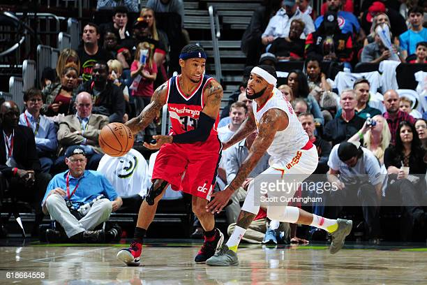 Trey Burke of the Washington Wizards handles the ball against Malcolm Delaney of the Atlanta Hawks on October 27 2016 at Philips Arena in Atlanta...