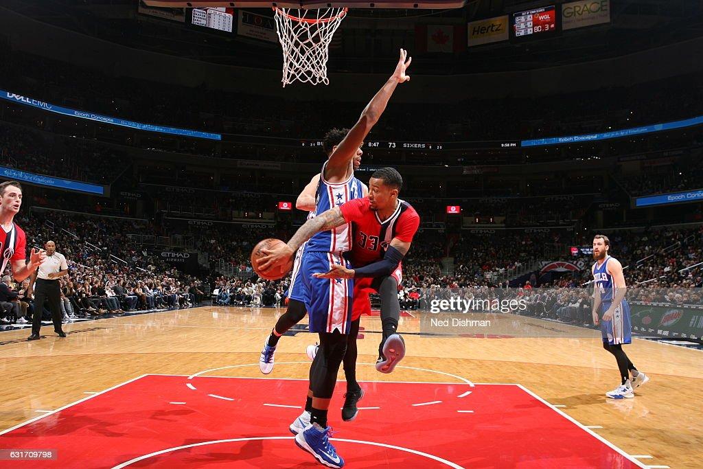 Trey Burke #33 of the Washington Wizards passes the ball against the Philadelphia 76ers on January 14, 2017 at Verizon Center in Washington, DC.