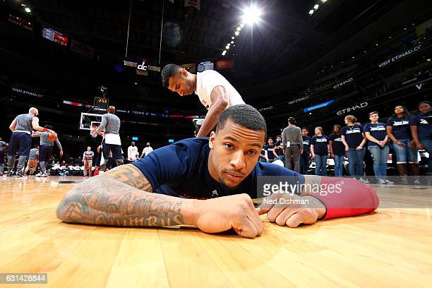 Trey Burke of the Washington Wizards stretches before the game against the Chicago Bulls on January 10 2017 at Verizon Center in Washington DC NOTE...