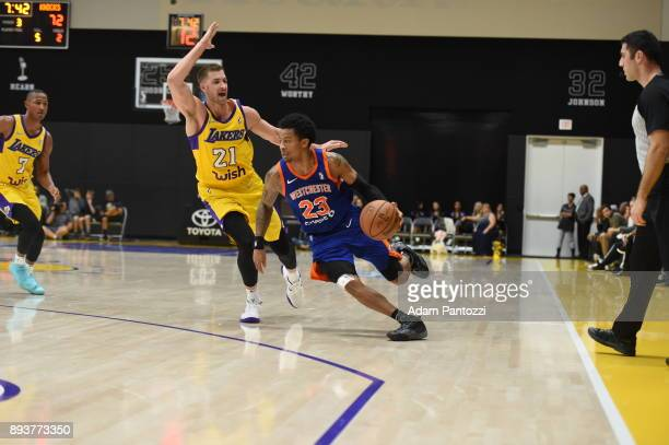 Trey Burke of the Westchester Knicks handles the ball against Travis Wear of the South Bay Lakers during an NBA GLeague game on December 15 2017 at...