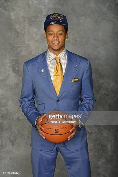 Trey Burke poses for a portrait after being selected during the 2013 NBA Draft at the Barclays Center on June 27 2013 in Brooklyn New York NOTE TO...