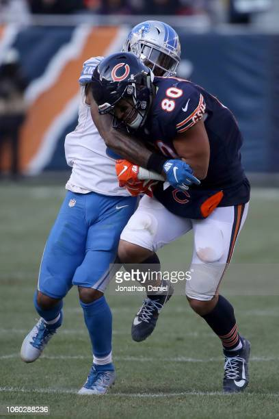Trey Burton of the Chicago Bears carries the football against Tavon Wilson of the Detroit Lions in the third quarter at Soldier Field on November 11...