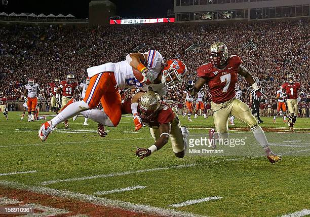 Trey Burton of the Florida Gators is forced out of bounds by Terrence Brooks of the Florida State Seminoles during a game at Doak Campbell Stadium on...