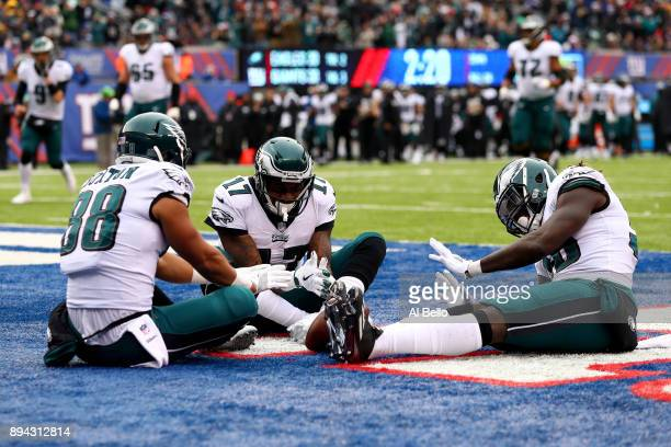 Trey Burton of the Philadelphia Eagles celebrates with Alshon Jeffery and Jay Ajayi scoring a 13 yard touchdown pass against the New York Giants...