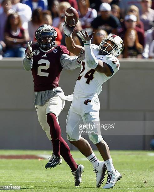 Trey Caldwell of the Louisiana Monroe Warhawks knocks the ball away from Speedy Noil of the Texas AM Aggies in the fourth quarter at Kyle Field on...