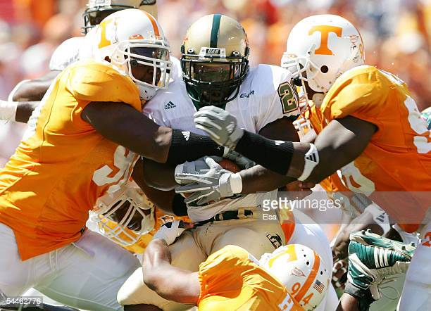 Trey Chaney of the UAB is hitby Turk McBride and Parys Haralson of Tennessee on September 3, 2005 at Neyland Stadium in Knoxville, Tennessee. The...