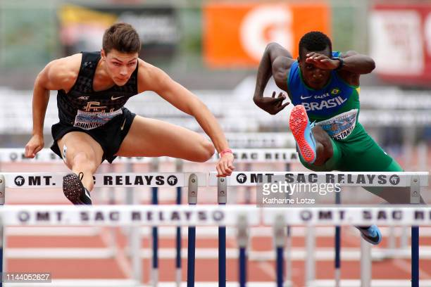 Trey Cunningham of Florida State and Gabriel Constantino of Brazil run the men's 110 high hurdles on the second day of the 61st Mt SAC Relays at...