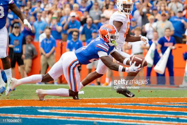 Trey Dean III of the Florida Gators intercepts a throw from Jarrett Guarantano of the Tennessee Volunteers during the first half of the game at Ben...