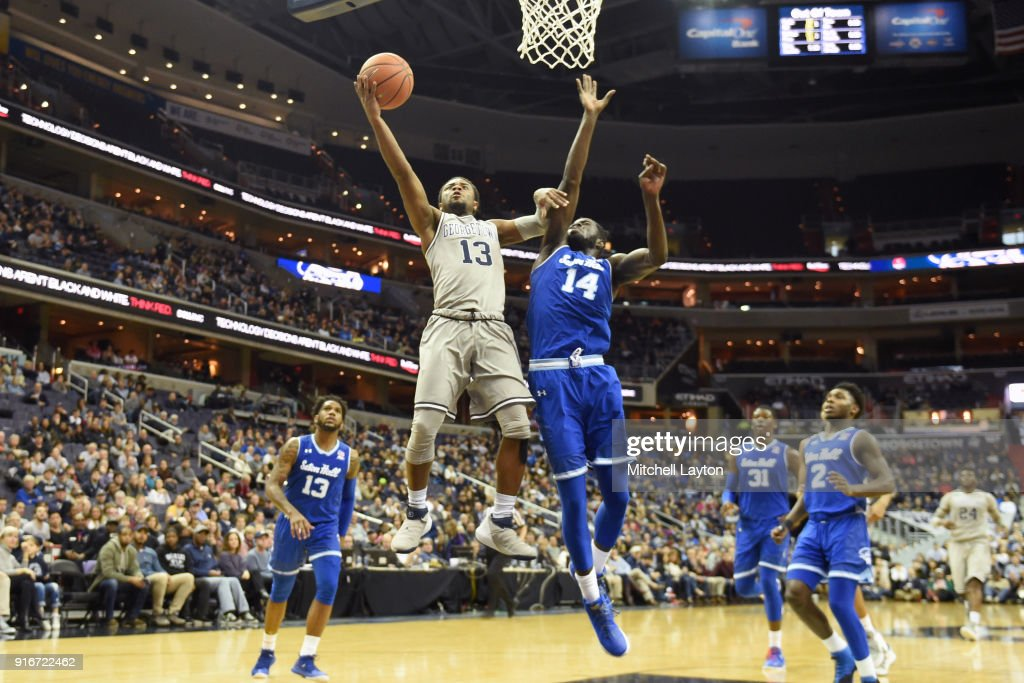 Trey Dickerson #13 of the Georgetown Hoyas drives to the basket by Ismael Sanogo #14 of the Seton Hall Pirates during a college basketball game at Capital One Arena on February 10, 2018 in Washington, DC.