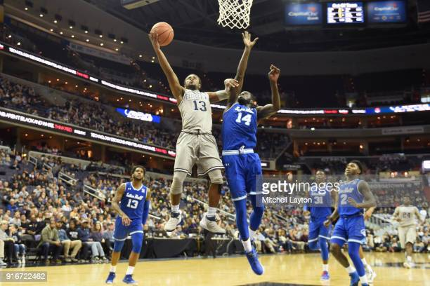 Trey Dickerson of the Georgetown Hoyas drives to the basket by Ismael Sanogo of the Seton Hall Pirates during a college basketball game at Capital...