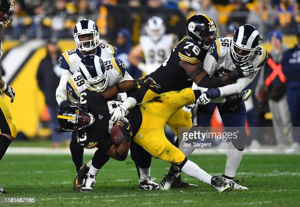 Trey Edmunds of the Pittsburgh Steelers is tackled by Aaron Donald and Dante Fowler of the Los Angeles Rams during the fourth quarter at Heinz Field...