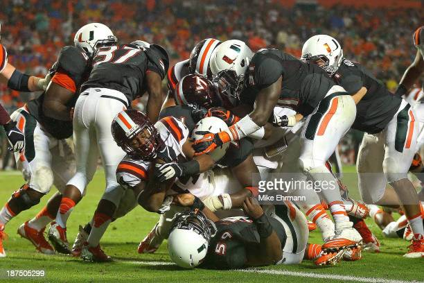 Trey Edmunds of the Virginia Tech Hokies rushes for a touchdown during a game against the Miami Hurricanes at Sun Life Stadium on November 9, 2013 in...
